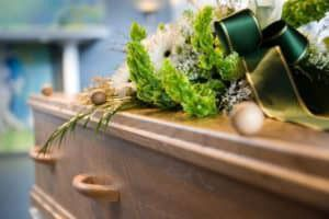 9132924 - a coffin with a flower arrangement at a mortuary